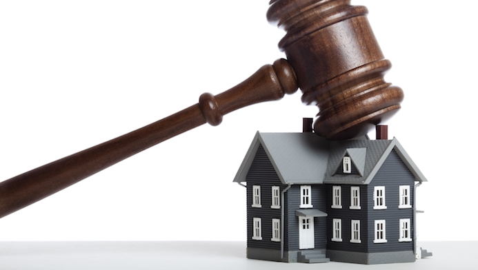 Selling property at auction: Quote it low, watch it go?
